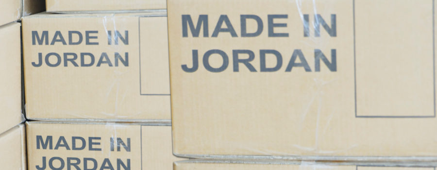 Stacks of cardboard boxes marked 'Made in Jordan'